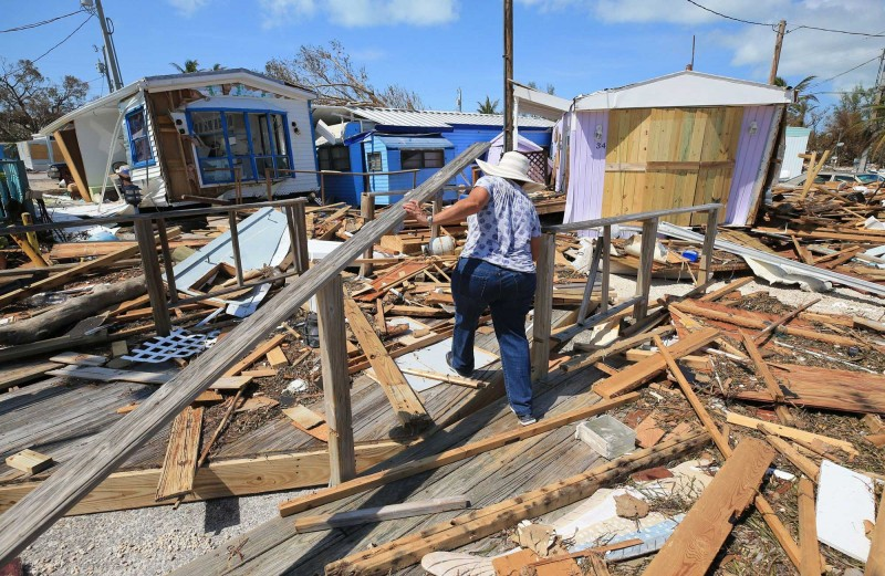 Mirta Mendez walks through the debris at the Seabreeze trailer park along the Oversees Highway in the Florida Keys on Tuesday, September 12, 2017.