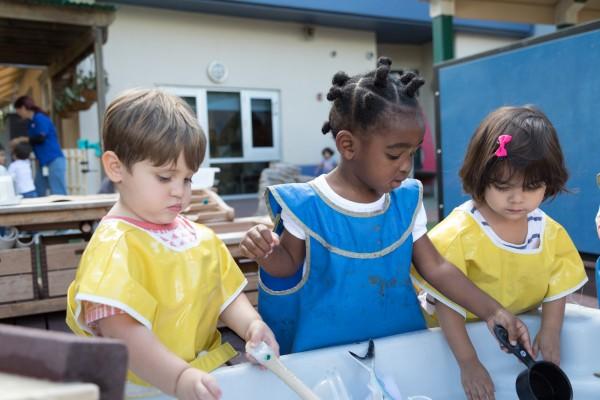 United Way Center children planting seeds