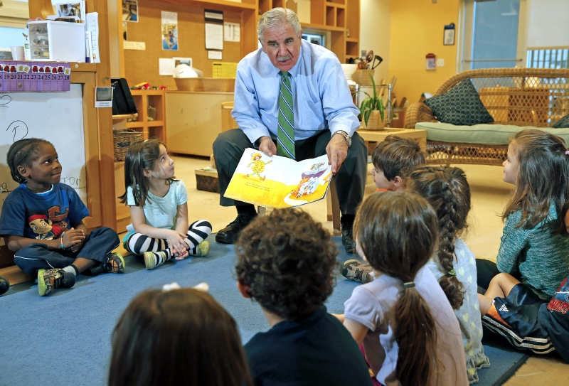 Harve A. Mogul, President and CEO of United Way of Miami-Dade, reads to students at the United Way Center for Excellence in Early Education Center on Tuesday, February 3, 2015