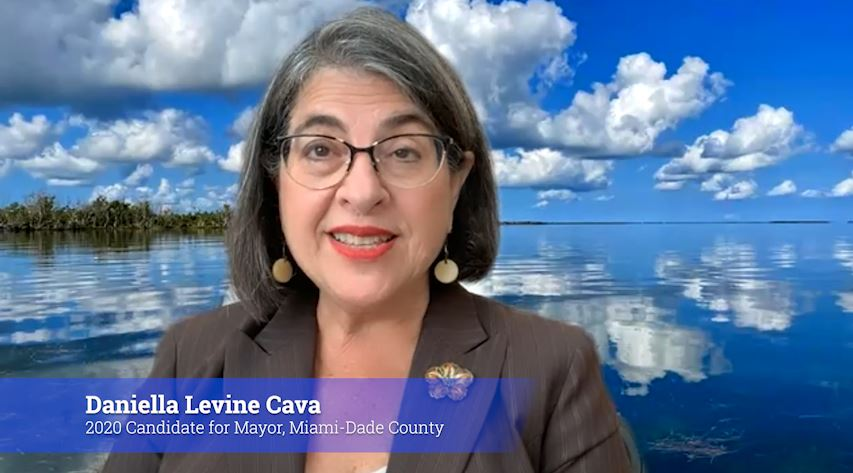 Daniella Levine Cava speaking to the camera in front of a water background
